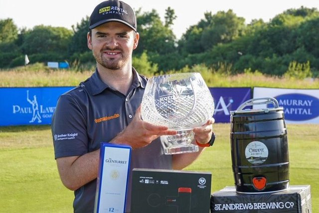 Craig Lawrie shows off the trophy after his two-shot win in the Farmfoods Scottish Par 3 Championship. Picture: Tartan Pro Tour