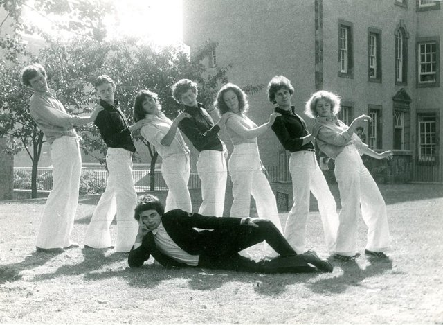 1976 Oxford Revue - Monica Kendall, third from the left, with Richard Curtis in front of her and Rowan Atkinson on the grass