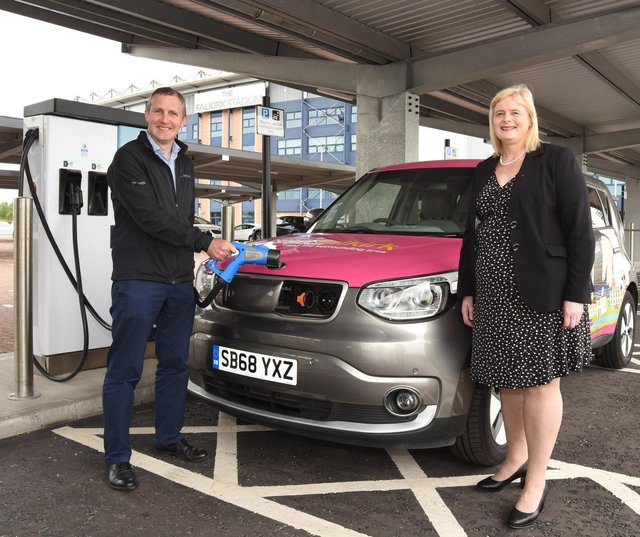 Transport Secretary Michael Matheson officially opening the Falkirk Stadium charging hub with Falkirk Council leader Cecil Meiklejohn last August