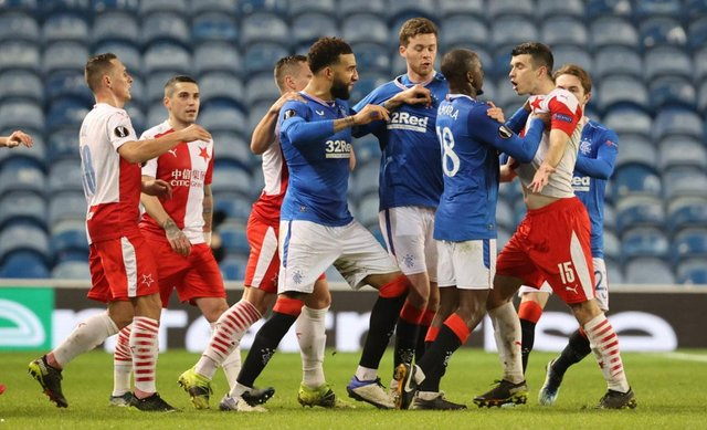 Rangers and Slavia Prague players clash on the pitch at Ibrox during the Europa League last 16 clash.  (Photo by Alan Harvey / SNS Group)