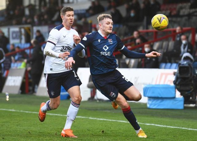 Ross County's Coll Donaldson competes with Cedric Itten during the Scottish Premiership match between Ross County and Rangers at the Global Energy Stadium on December 06, 2020, in Dingwall, Scotland. (Photo by Craig Foy / SNS Group)