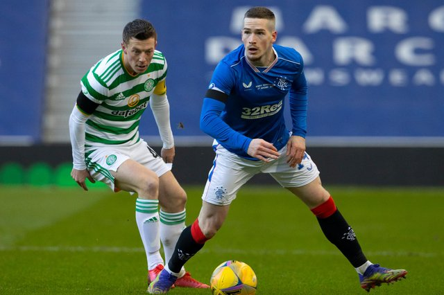 Celtic's Callum McGregor keeps a close eye on Rangers winger Ryan Kent during the last Old Firm clash