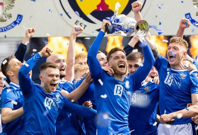 St Johnstone defender Jamie McCart holds the Scottish Cup aloft during the post-match celebrations at Hampden. (Photo by Craig Williamson / SNS Group)