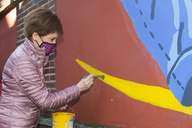Nicola Sturgeon at the Barrowlands in Glasgow to see the Shuggie Bain Mural painted by artists Erin Bradley-Scott, Chelsea Frew and Kat Louden from the Cobalt Collective.