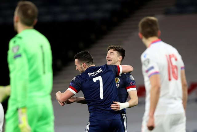 John McGinn of Scotland celebrates with team mate Kieran Tierney after scoring their side's first goal during the FIFA World Cup 2022 Qatar qualifying match between Scotland and Faroe Islands at Hampden Park on March 31, 2021 in Glasgow, Scotland. (Photo by Ian MacNicol/Getty Images)