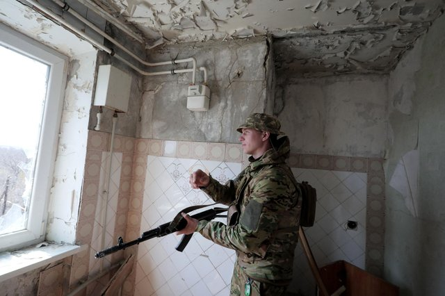 A Ukrainian soldier stands near the front line with Russia-backed separatists in the small town of Pisky, near Donetsk (Picture: Aleksey Filippov/AFP via Getty Images)