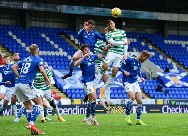 Mohamed Elyounoussi of Celtic and Murray Davidson of St Johnstone battle for the ball. (Photo by Mark Runnacles/Getty Images)