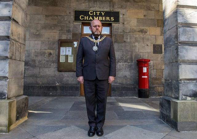 Edinburgh's Lord Provost Frank Ross observes the minute silence for the Duke of Edinburgh outside Edinburgh City Chambers on Saturday, April 17 (Photo: Lisa Ferguson).