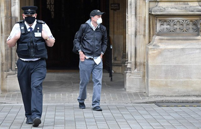 Former number 10 special advisor Dominic Cummings waits for a taxi as he leaves Parliament after giving evidence to a Parliamentary committee hearing. Picture: Justin Tallis/AFP via Getty Images