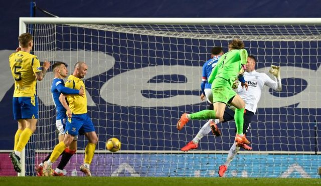 Zander Clark's downward header is turned in by St Johnstone striker Chris Kane to make it 1-1 in stoppage time during the dramatic Scottish Cup tie at Ibrox. (Photo by Rob Casey / SNS Group)