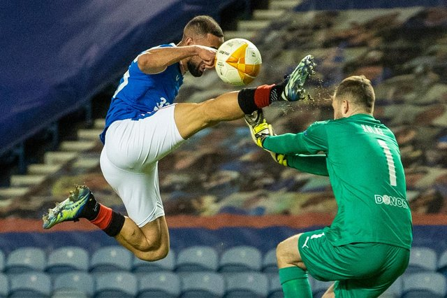 Rangers striker Kemar Roofe catches Slavia Prague goalkeeper Ondrej Kolar in the face with his boot before receiving a red card during the Europa League match at Ibrox on March 18  (Photo by Alan Harvey / SNS Group)