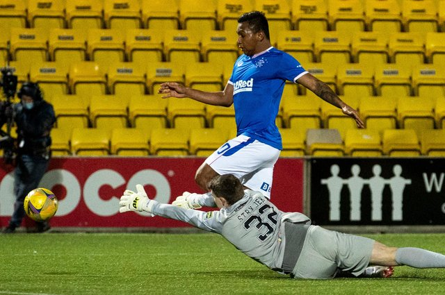 Alfredo Morelos goes down under the attentions of Livingston goalkeeper Max Stryjek. Picture: SNS