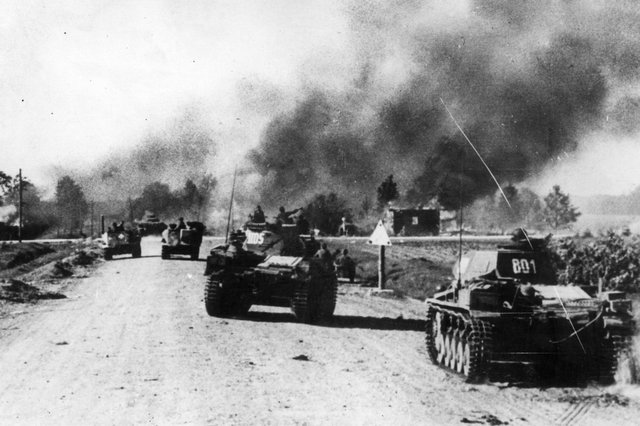 July 1941: Panzer units of the German Army pass through a blazing Russian village, torched by the evacuees, during Operation Barbarossa PIC: Keystone/Getty Images