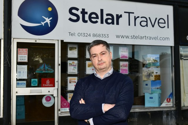 John Barr, owner of Stelar Travel in Stenhousemuir, is calling on the Scottish Government to provide greater support to the travel industry amid the coronavirus crisis. Picture: Michael Gillen.