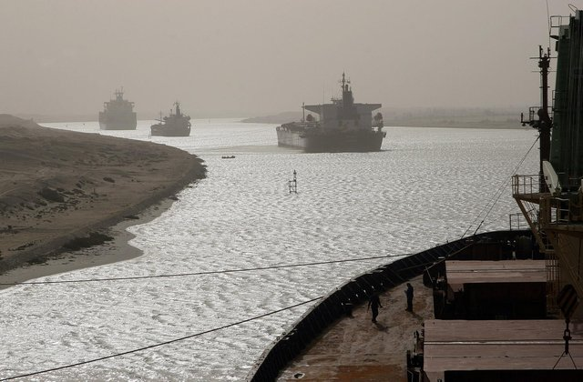 A cargo ship has turned sideways in Egypt's Suez Canal, blocking traffic in a crucial East-West waterway for global shipping. (Photo by Christos GOULIAMAKIS / AFP)