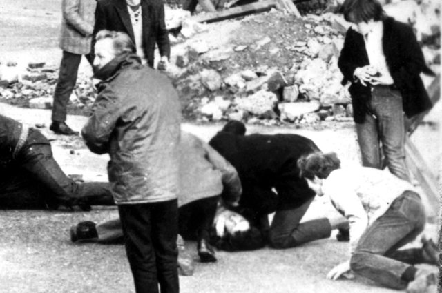 A man receives attention during the Bloody Sunday shootings in Londonderry, Northern Ireland, in 1972 (Picture: PA Wire)