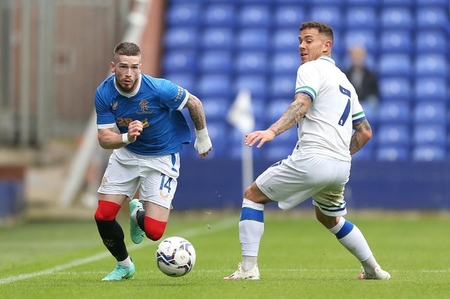 Ryan Kent of Rangers looks to get past Tranmere Rovers' goalscorer Kieron Morris during the pre-seaon meeting between the two sides at Prenton Park