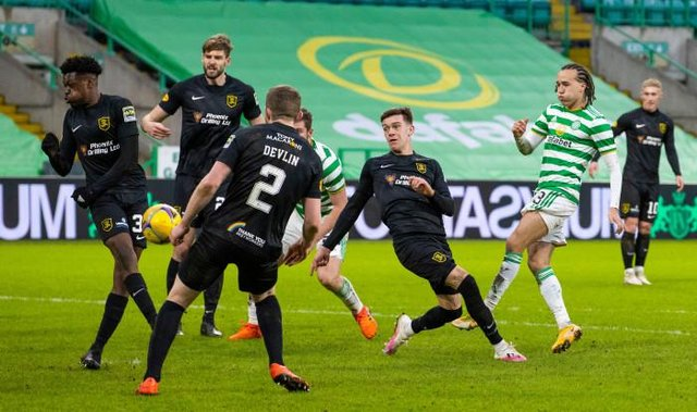 Celtic's Diego Laxalt (R) has a second half shot blocked during a Scottish Premiership match between Celtic and Livingston at Celtic Park on January 16, 2021, in Glasgow, Scotland. (Photo by Alan Harvey / SNS Group)