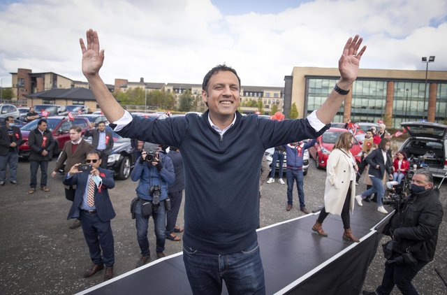 Scottish Labour leader Anas Sarwar on stage at a drive-in rally in Glasgow during campaigning for the Scottish Parliamentary election.