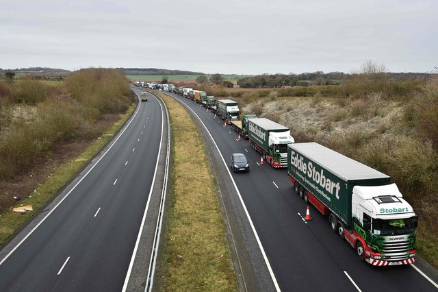 Lorries practice queuing on the A256 a few miles north of Dover in preparation for the end of the Brexit transition period (Picture: Glyn Kirk/AFP via Getty Images)