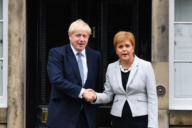 Nicola Sturgeon and Boris Johnson both need to demonstrate greater urgency over a public inquiry into the Covid pandemic (Picture: Jeff J Mitchell/Getty Images)