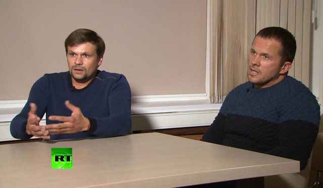 Ruslan Boshirov, left, and Alexander Petrov attend their first public appearance in an interview with the Kremlin-funded RT channel in Moscow, Russia. Picture: RT channel video via AP