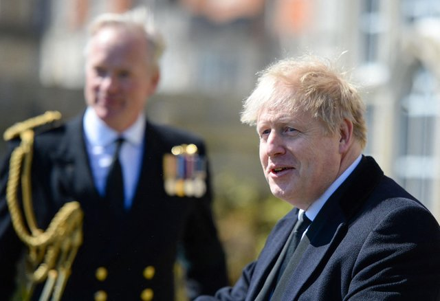 British Prime Minister Boris Johnson (right) attends a Passing-out parade at Britannia Royal Naval College, in Dartmout. Picture: Finnbarr Webster/POOL/AFP via Getty Images