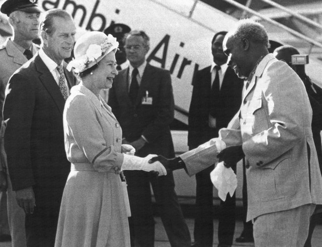 In this July 29, 1979 file photo, Zambia's President Kenneth Kaunda greets Britain's Queen Elizabeth II upon her arrival in Lusaka, Zambia on the final leg of her four-nation African tour. Zambia's first president Kenneth Kaunda has died at the age of 97, the country's president Edward Lungu announced Thursday June 17, 2021. (AP Photo/File)