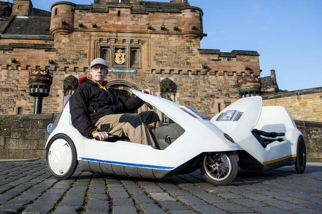 Chris Rockett in one of his Sinclair C5s in Edinburgh picture: Lisa Ferguson      Chris Rockett - Rockett Sinclair C5 Tours