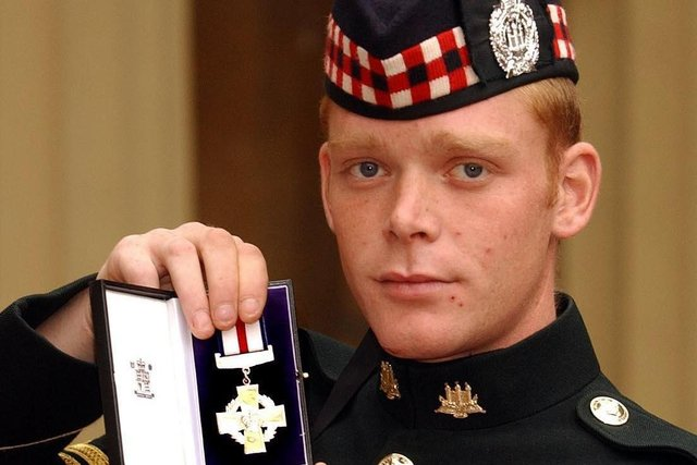 Corporal Shaun Jardine of the King's Own Scottish Borderers holds his conspicuous gallantry cross , after it was presented to him by the Queen, at Buckingham Palace in October 2004. Jardine recieved his medal after  storming two Iraq gun positions single handed while under fire. (Photo:John Stillwell.WPA Pool).