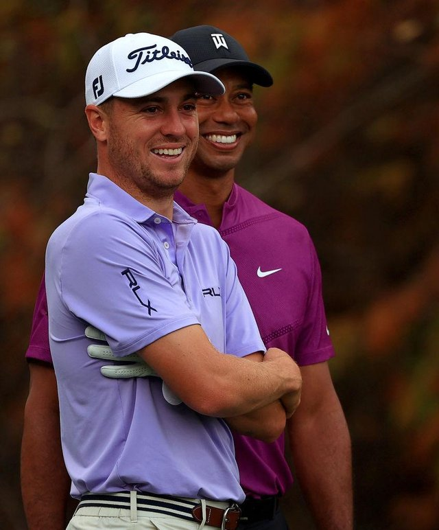 Justin Thomas and Tiger Woods, pictured during the PNC Championship in Florida last December, are close friends. Picture: Mike Ehrmann/Getty Images.