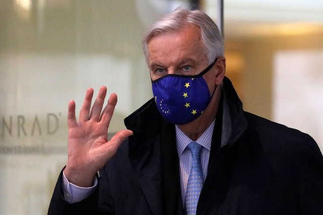 EU chief Brexit negotiator Michel Barnier, wearing an EU flag-themed facemask due to the novel coronavirus pandemic, leaves a hotel in London. Picture: Tolga Akmen/AFP via Getty Images