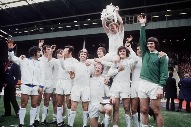 Leeds United celebrate winning the FA Cup: (left-right) Mick Bates, Paul Madeley, Eddie Gray, Paul Reaney, Johnny Giles, Jack Charlton, Allan Clarke, Billy Bremner, Peter Lorimer, Norman Hunter and David Harvey