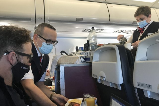 Staff serving food on the first BA holiday flight back to Lisbon.