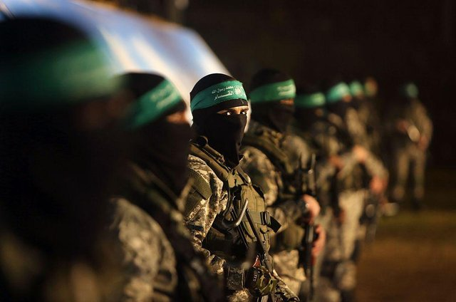 Members of the Izz ad-Din al-Qassam Brigades, the armed wing of the Hamas movement (Photo: MAHMUD HAMS/AFP via Getty Images)
