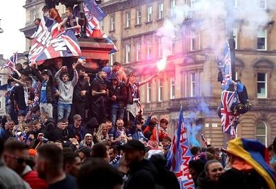 Five police officers were injured during the unrest in Glasgow's George Square as Rangers fans celebrated winning the Scottish Premiership title. Picture: Andrew Milligan/PA