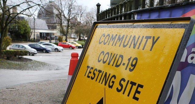 A Covid sign outside a community coronavirus testing centre.
