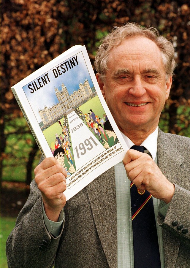 George Montgomery in 1991, with a book written by former pupils at Donaldson's College (Picture: Crauford Tait)