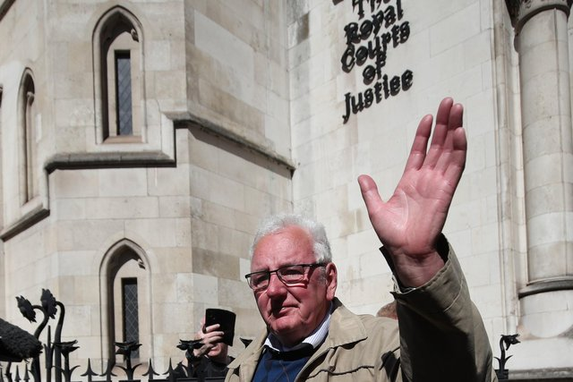 Former post office worker Noel Thomas, who was convicted of false accounting in 2006, waves as his leaves the Royal Courts of Justice, London, after having his conviction overturned by the Court of Appeal (Photo: Yui Mok/PA Wire).