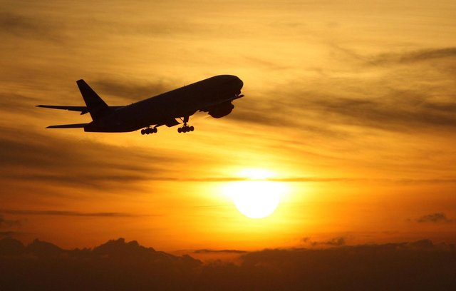 A plane taking off at sunset. Picture: Steve Parsons/PA Wire