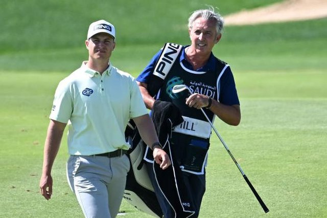 Calum Hill and caddie Phil Morbey during the Saudi International powered by SoftBank Investment Advisers at Royal Greens Golf and Country Club in King Abdullah Economic City. Picture: Ross Kinnaird/Getty Images.