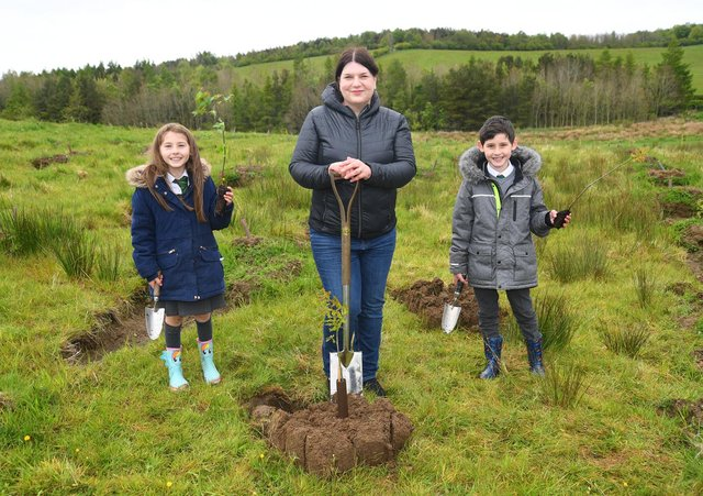 Councillor Susan Aitken, chair of Glasgow City Region cabinet and leader of Glasgow City Council, gets digging with local children as plans are unveiled to plant 18 million trees - ten for every adult and child in the area - as part of the new Clyde Climate Forest initiative