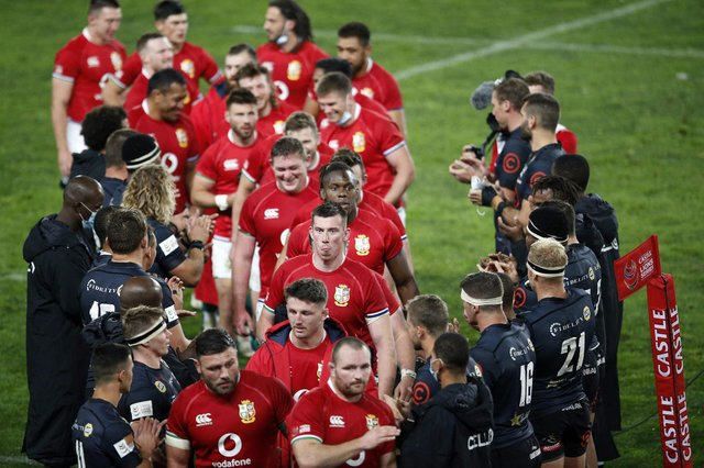 Sharks players form a guard of honour for the British and Irish Lions following the tourists' 54-7 win.