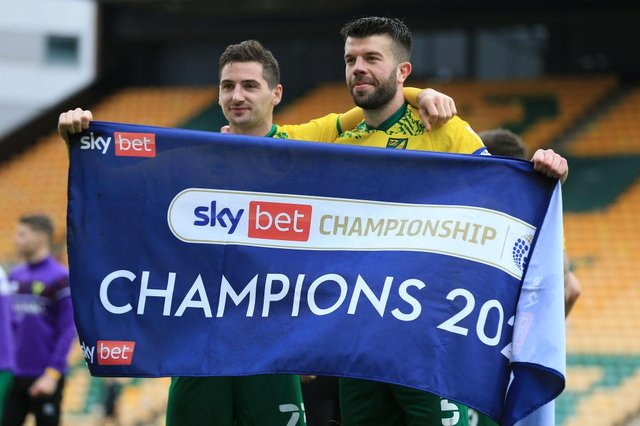 Kenny McLean and Grant Hanley of Norwich City celebrate winning the Sky Bet Championship. (Photo by Stephen Pond/Getty Images)