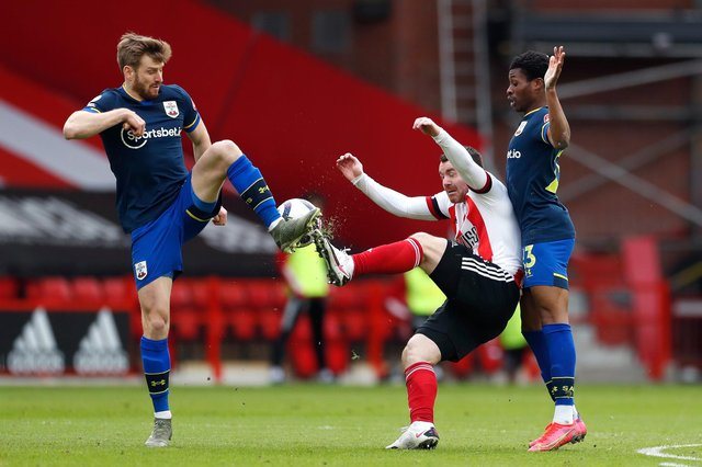 Scotland team-mates Stuart Armstrong and John Fleck challenge for the ball during a Southampton v Sheffield United match.