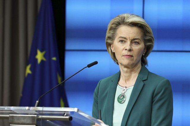 European Commission President Ursula von der Leyen listens to a question during an online news conference at the end of a EU summit at the European Council building in Brussels, Thursday, March 25, 2021. European Union leaders struggled Thursday to solve quarrels about the distribution of COVID-19 vaccine shots as they tried to ramp up inoculations across their 27 nations amid a shortage of doses, spikes in new cases and a feud with the United Kingdom. (Aris Oikonomou, Pool Photo via AP)