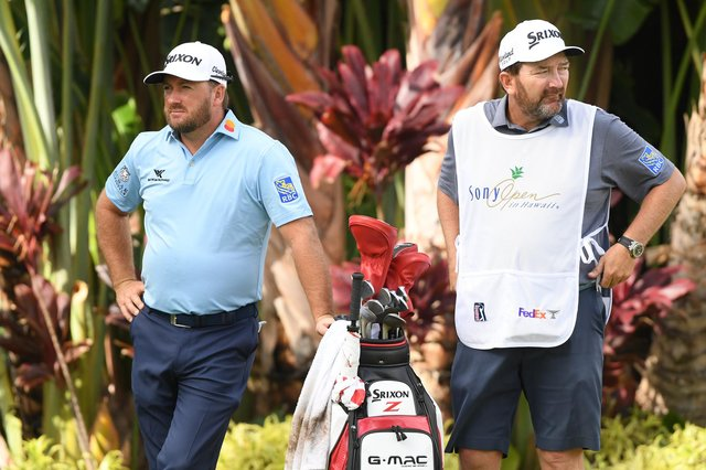 Graeme McDowell, left, with his caddie Ken Comboy who has tested positive for Covid-19.