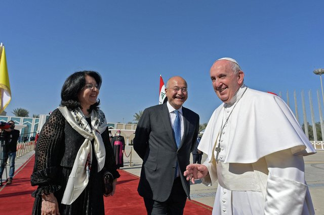 Iraq's President Barham Saleh and his wife Sarbagh bid farewell to Pope Francis at Baghdad International Airport (Picture: Vatican Media/AFP via Getty Images)
