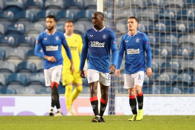 Glen Kamara of Rangers looks dejected after the second goal during the UEFA Europa League Round of 16 Second Leg match between Rangers and Slavia Praha at Ibrox Stadium on March 18, 2021 in Glasgow, Scotland. (Photo by Andrew Milligan - Pool/Getty Images)