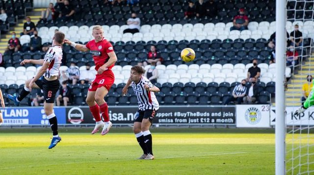 St Mirren striker Curtis Main leaps between Dunfermline duo Kyle Macdonald and Aaron Comrie to score in the Premier Sports Cup match in Paisley. (Photo by Alan Harvey / SNS Group)